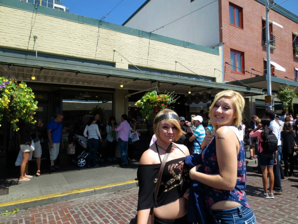 Courtney and Aspen in front of the first Starbucks
