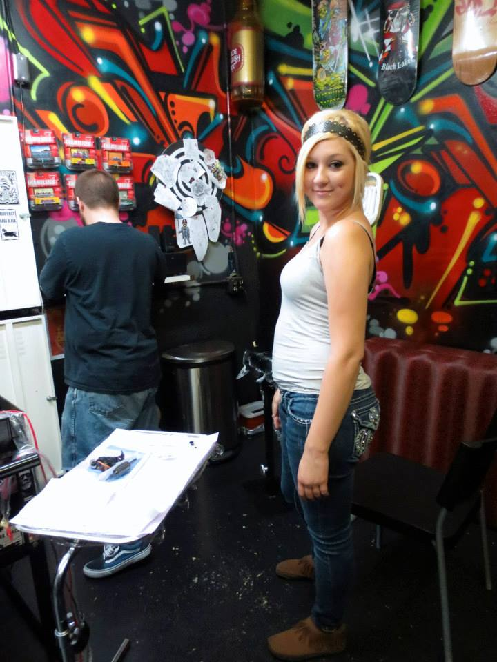 Courtney waiting to get her first tattoo.