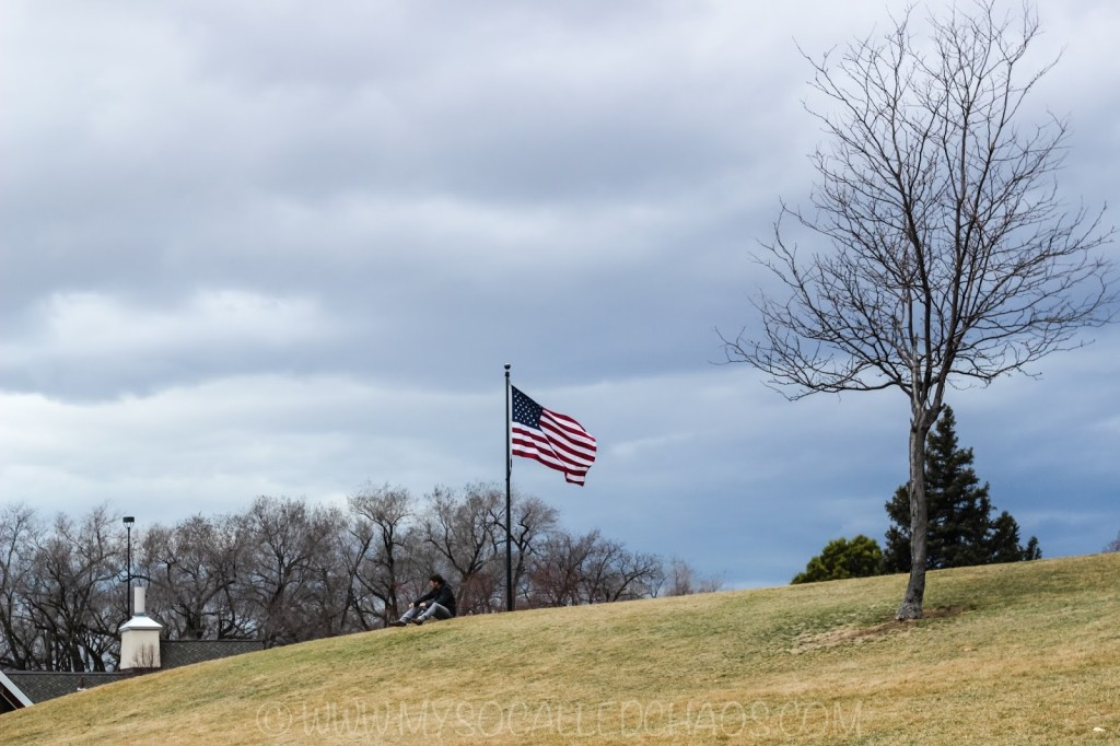Flag and person at Liberty Park in Salt Lake City, UT