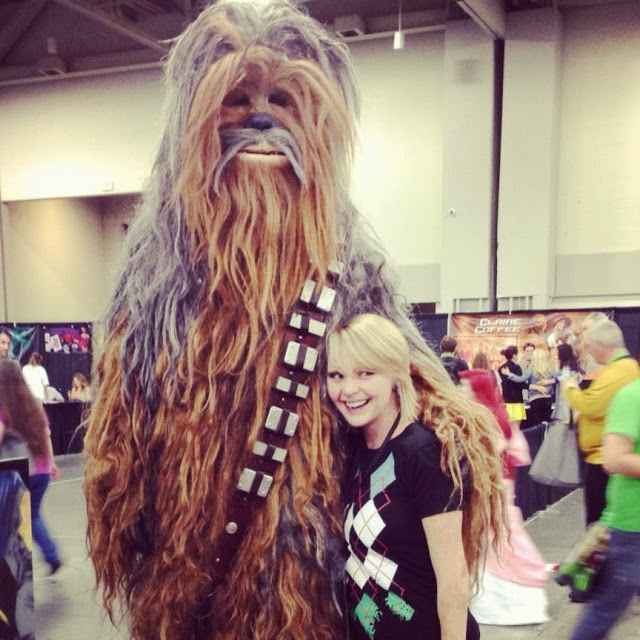 Heather form The Nerdy Fox posing with Chewbacca at ComicCon