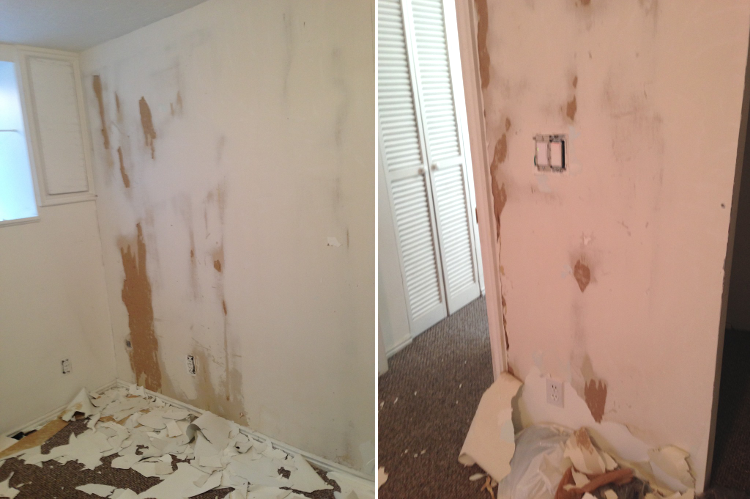 Scraping paint off of drywall.