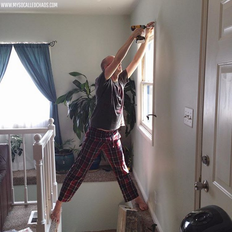 Josh hanging curtains.