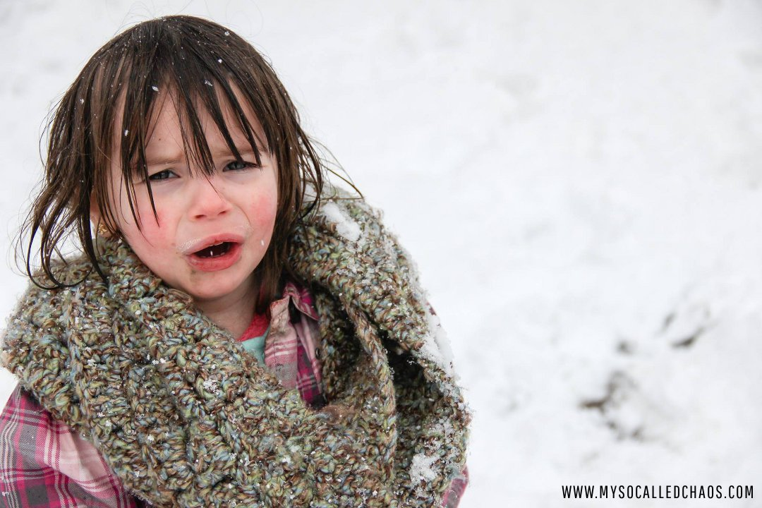 Katya crying in the snow.