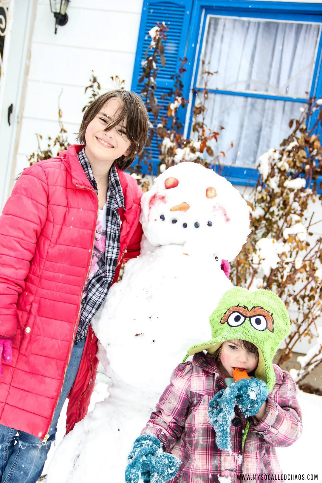 Kailee and Kat with their Snowman.