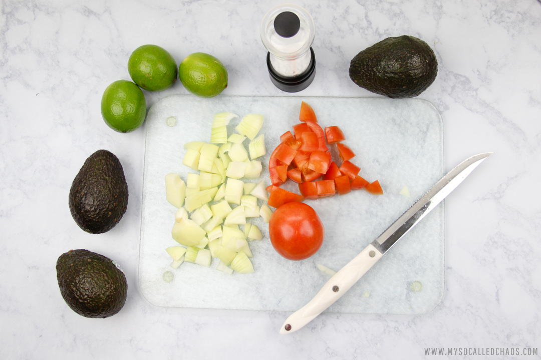 Chop up your onions and tomatoes for Chunky Guacamole.