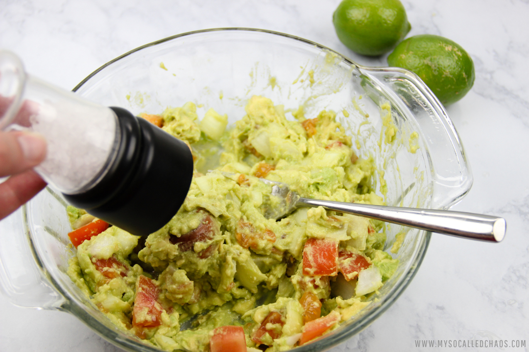 Add salt for flavoring in your fresh guacamole.