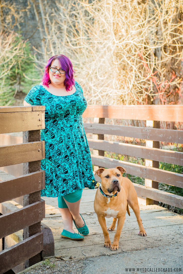 How to Prepare For and Get Bright-Colored Hair That Looks Great & Outfit Detials - Image shows a plus sized girl in a blue skull dress with purple hair and a pitbull