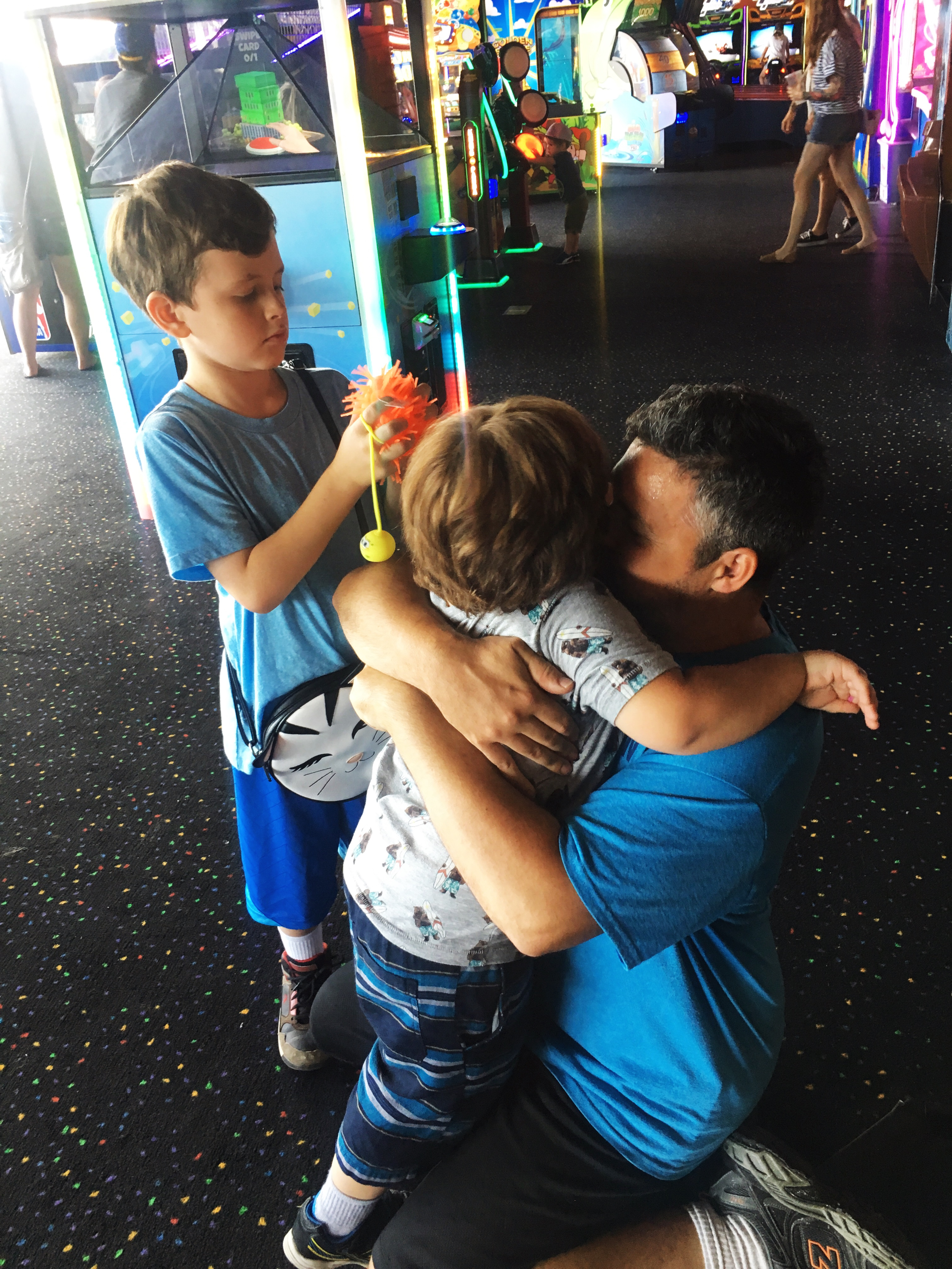 C hugging his boys at Fat Cats