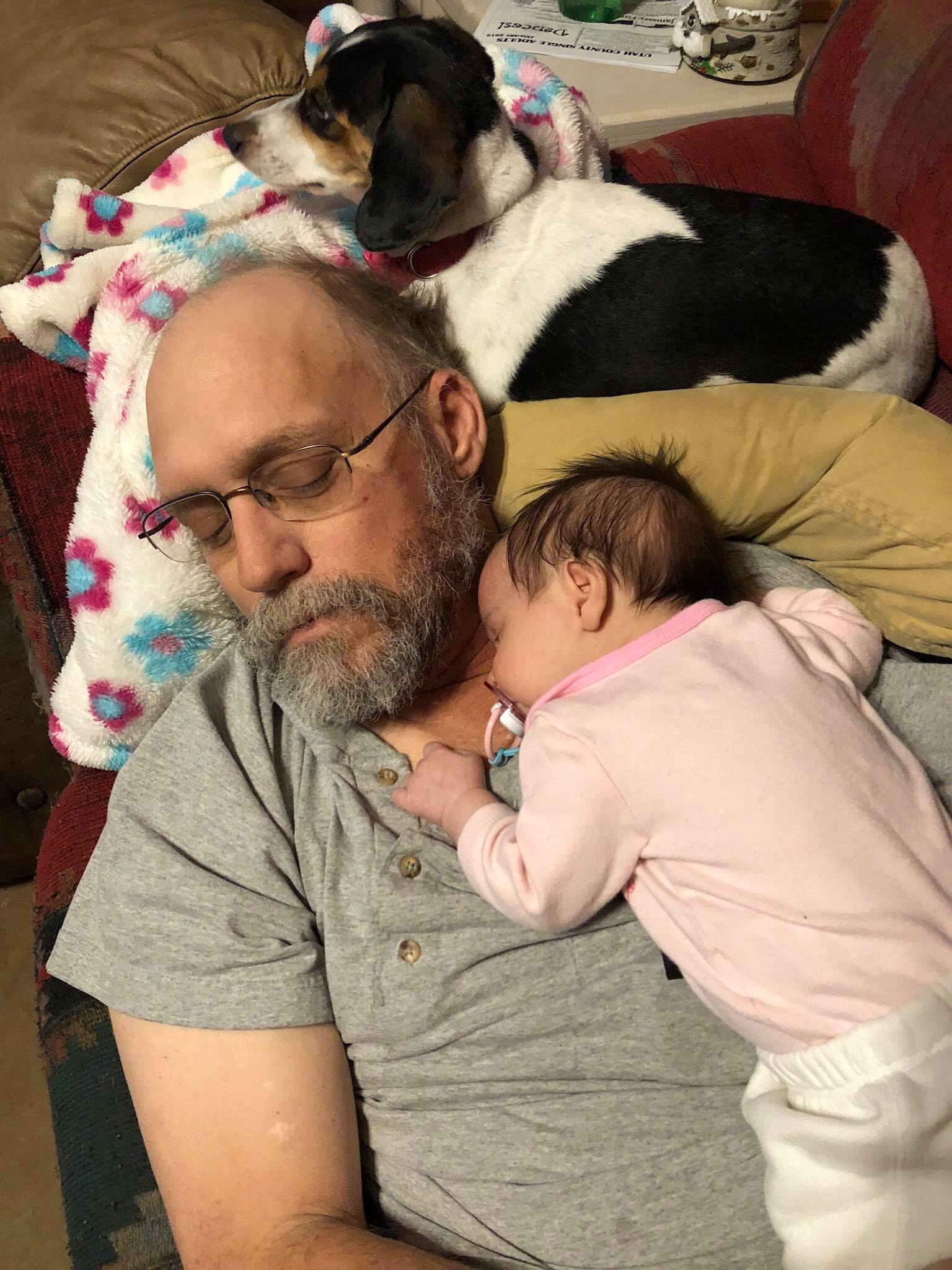 Amélie snuggling with Grandpa and Winkie.