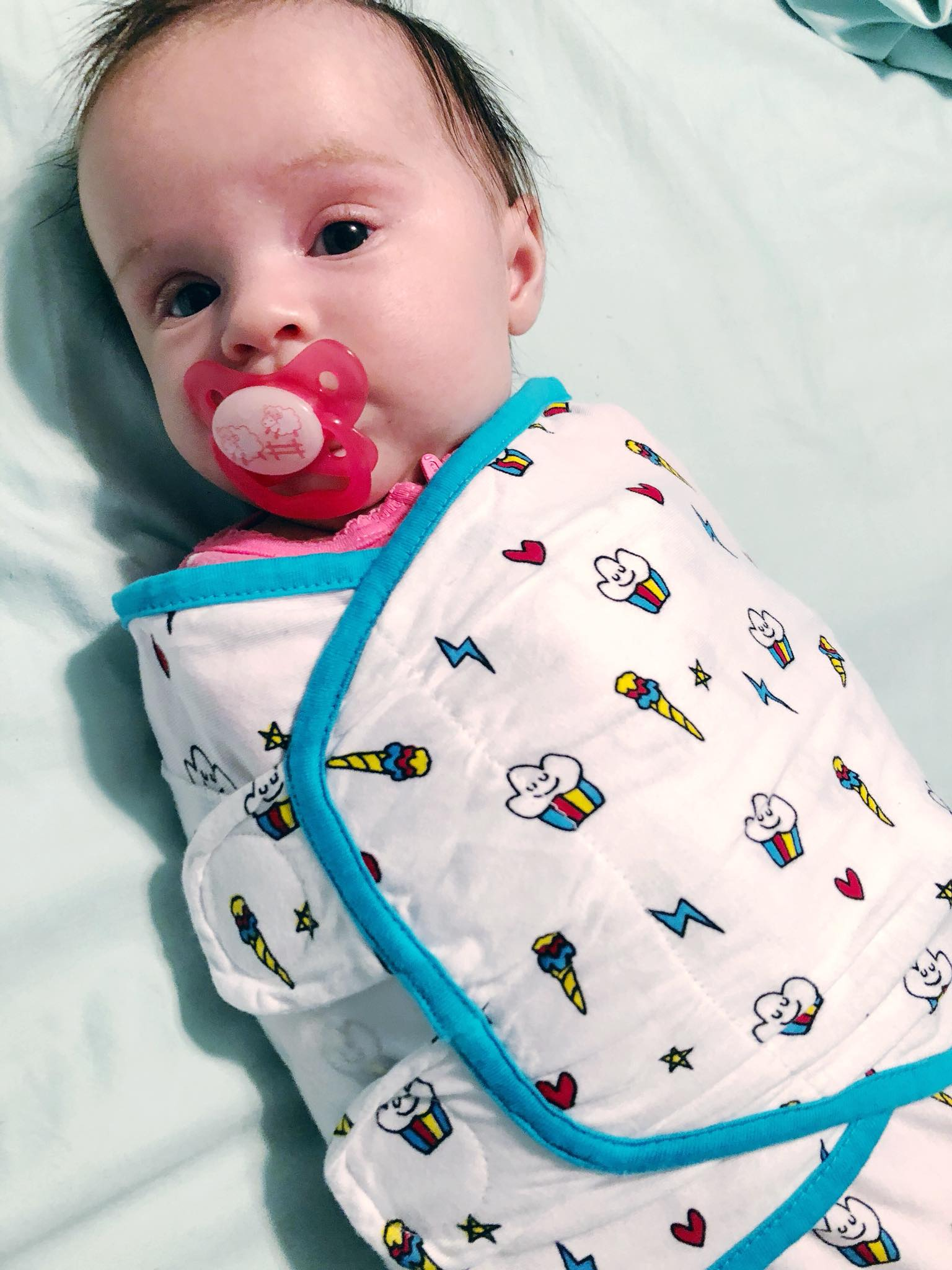 Amelie wearing her Ziggy Baby Cupcake Swaddle before bed