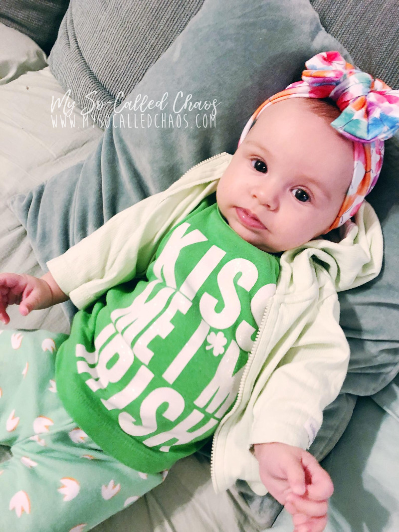"Baby girl wearing green for St. Patrick's Day and a shirt that says ""Kiss Me I'm Irish"""