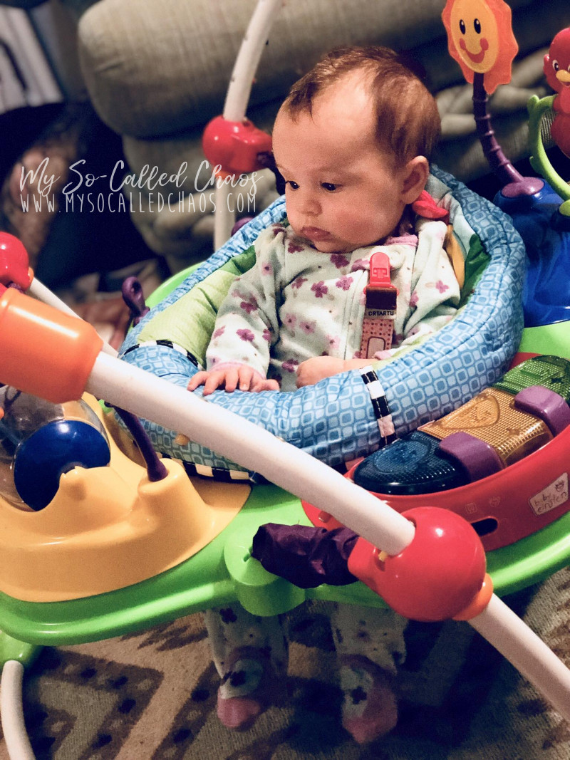 Four-month-old baby girl enjoying her Baby Einstein's Jumper before bed