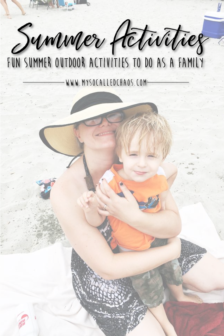 "Pinnable image for ""Fun Summer Outdoor Activities To Do As A Family"" showing a mom in a sun hat holding her son at the beach"