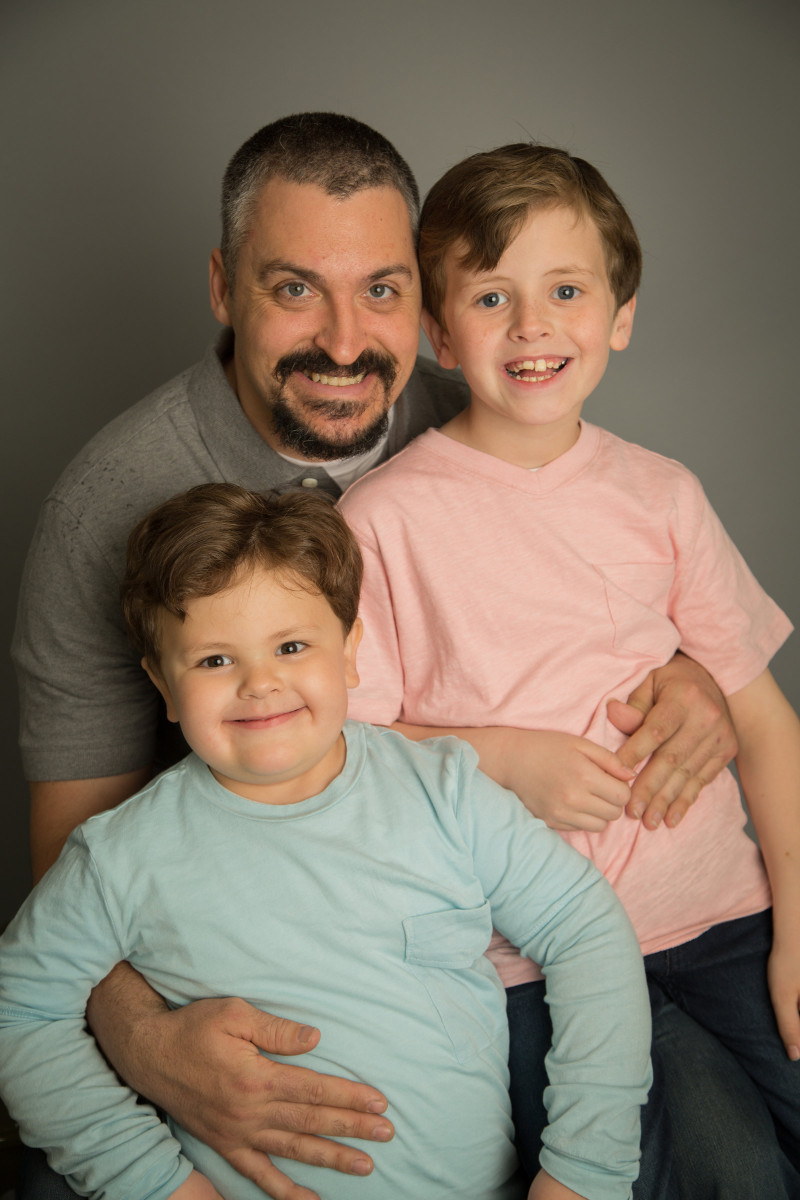 Professional family photo by Cat Palmer of a loving father with his two sons