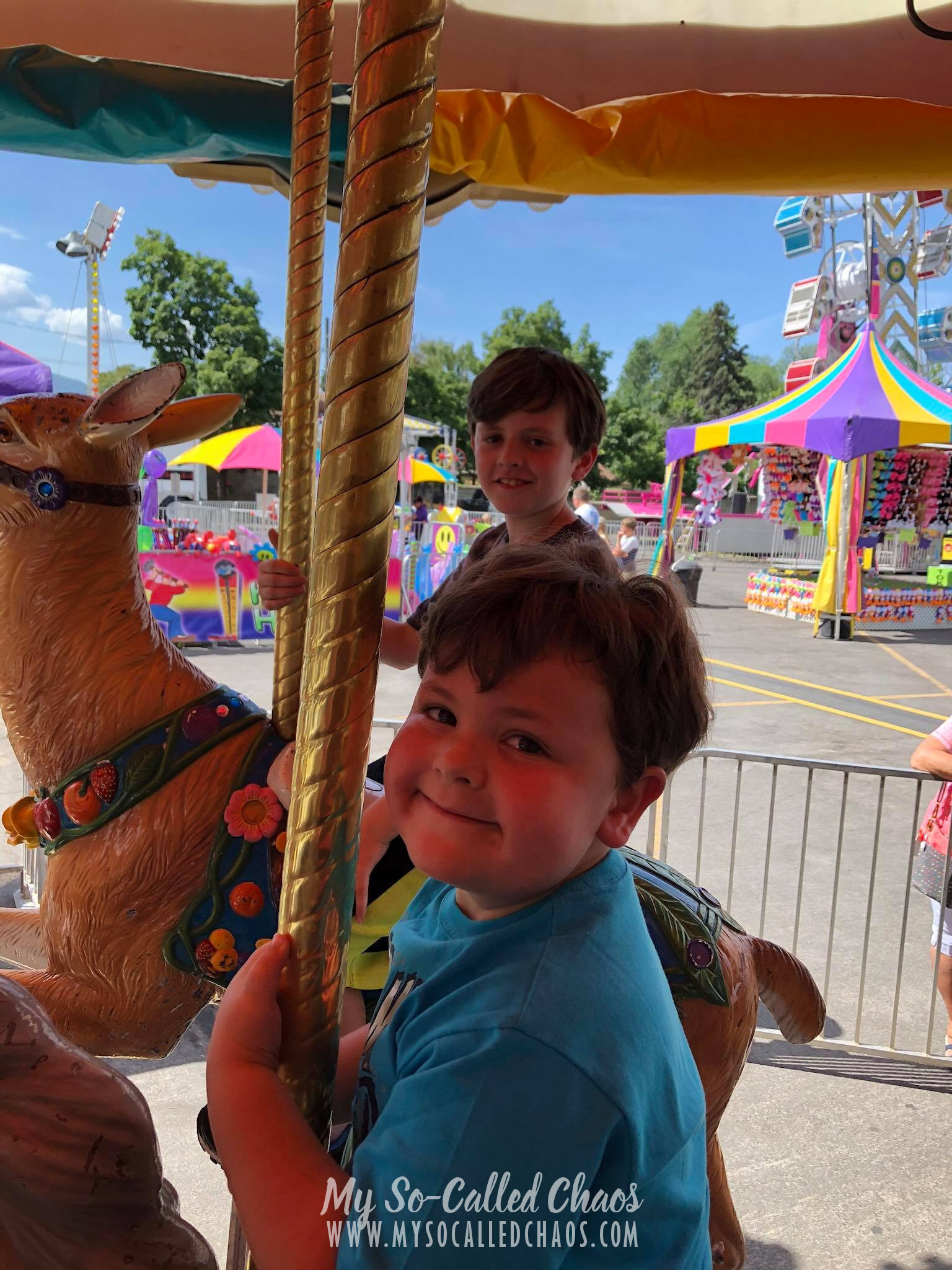 Kids riding the Carousel at Fiesta Days in Spanish Fork, UT