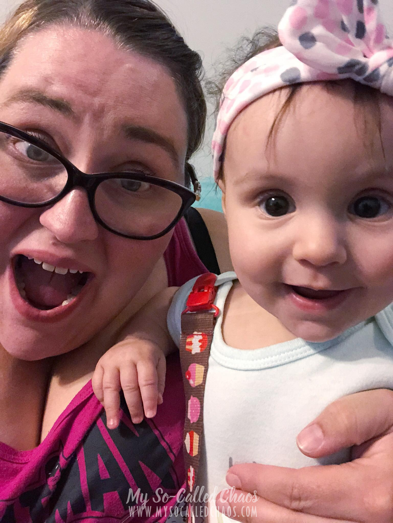 Adorable smiling baby and her momma with a surprised look on her face