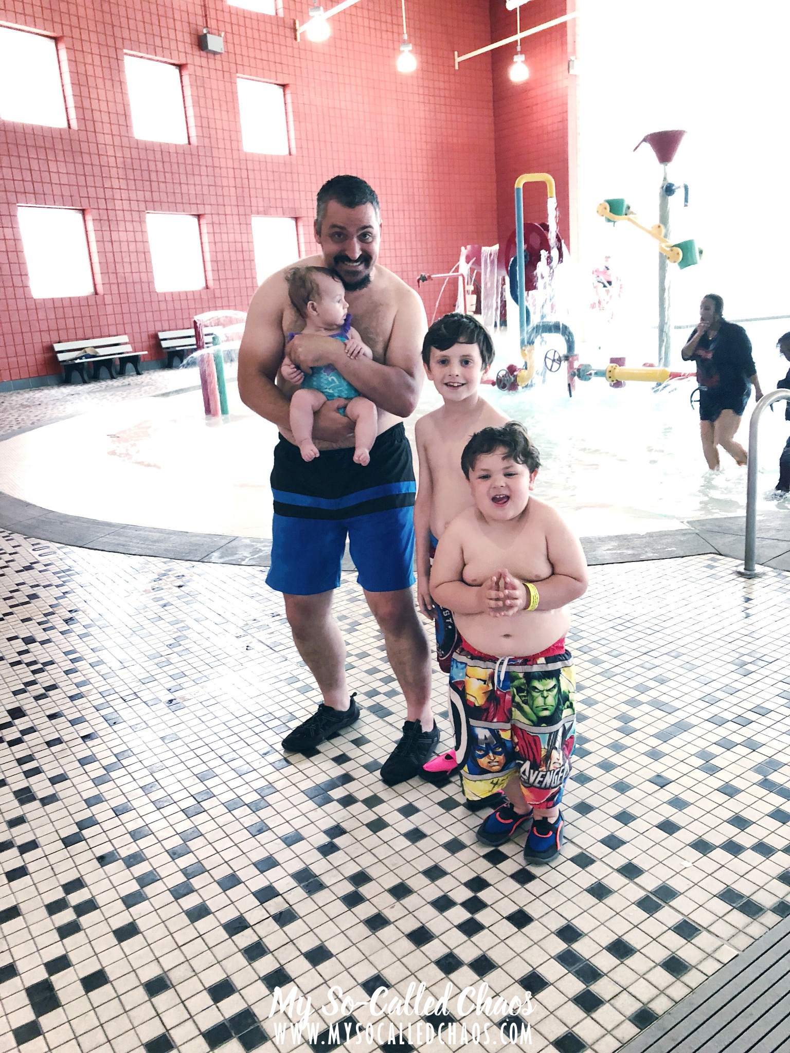 Man and his three children standing at an indoor pool in Salt Lake City, UT