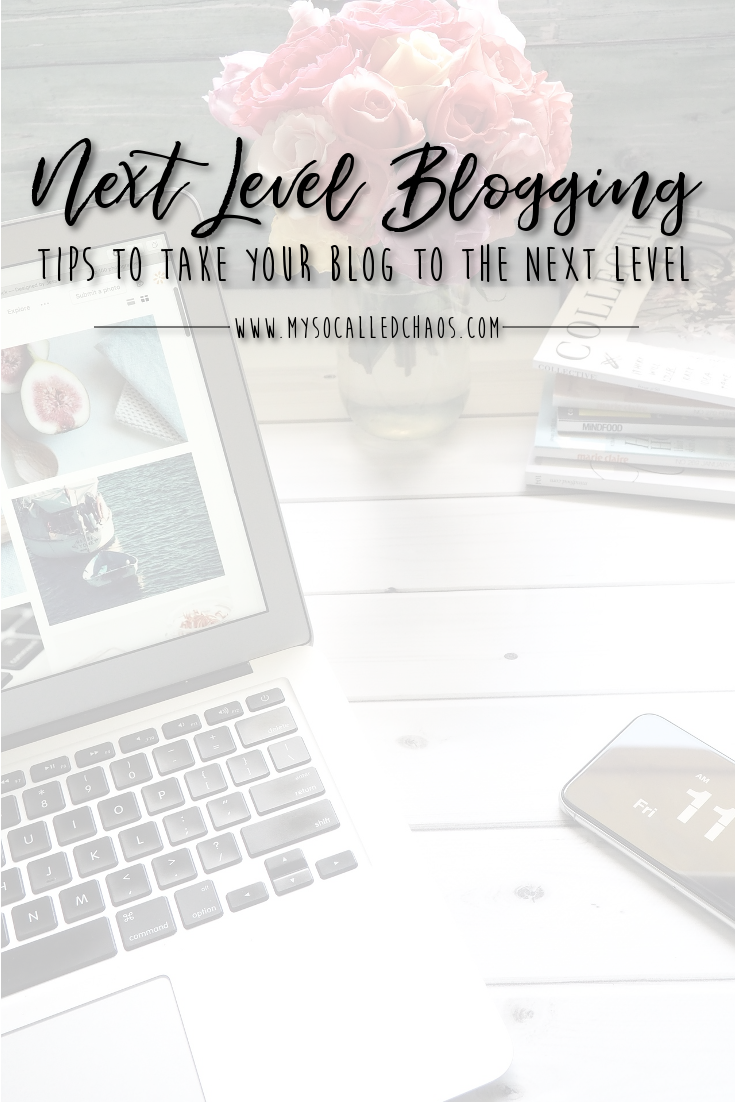 Tips To Take Your Blog To the Next Level - Laptop on a desk with a mouse, flowers, and magazine.