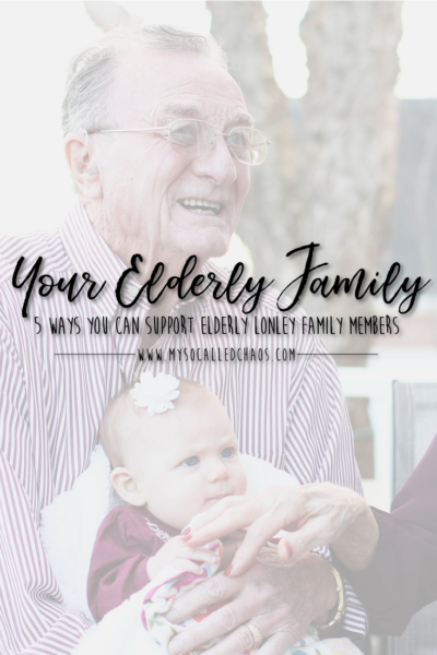 Five Ways You Can Support Elderly Lonely Family Members - image of a grandpa holding a little baby.
