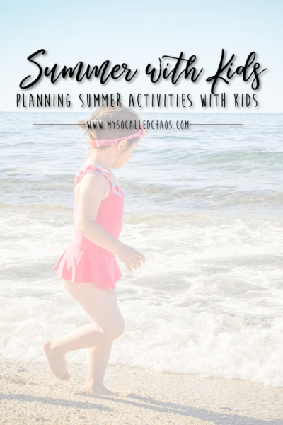 Planning Summer Activities With Your Kids - Little girl running along the beach playing in the waves in a pink swimsuit
