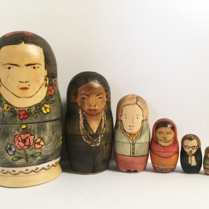 Nesting Dolls depicting famous women in history handmade from Etsy - They show Frida Kahlo, Nina Simone, Virginia Wolfe, Malala Yousafzai, Ruth Bader Ginsberg, Silvia Plath, and Anne Frank.