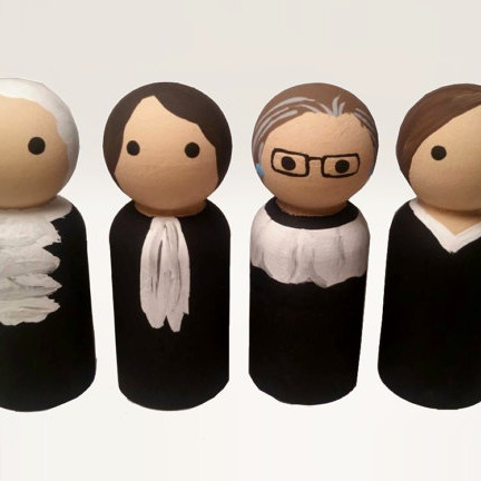 Women of the Supreme Court Peg Dolls featuring Ruth Bader Ginsberg, Sandra Day O'Connor, Elena Kagan, and Sonia Sotomayer.