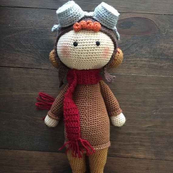 Adorable and spunky crocheted Amelia Earhart Doll made by Margaret Avenue on Etsy.