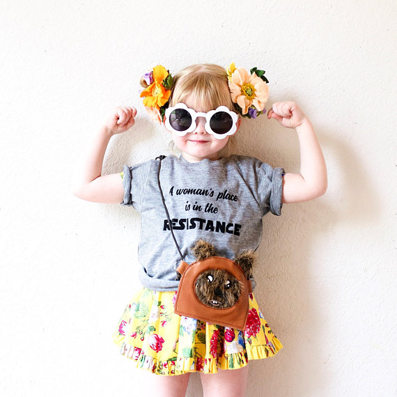 "Little girl wearing flower glasses, flower bows, an ewok purse, and a Star Wars inspired feminist tee that says ""a woman's place is in the resistance"" handmade on Etsy"