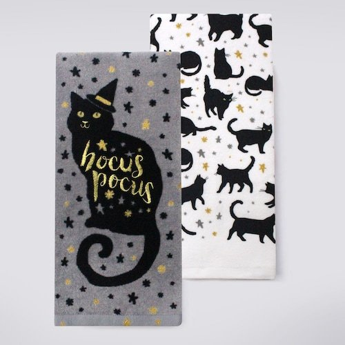 Adorable kitchen towels with a black cat pattern and a black cat with a witch hat and Hocus Pocus on it, he reminds me of Thackery Binx from Hocus Pocus