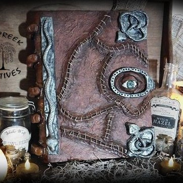 An amazing art figurine of the Spell Book from Hocus Pocus, created by Cold Creek Primitives