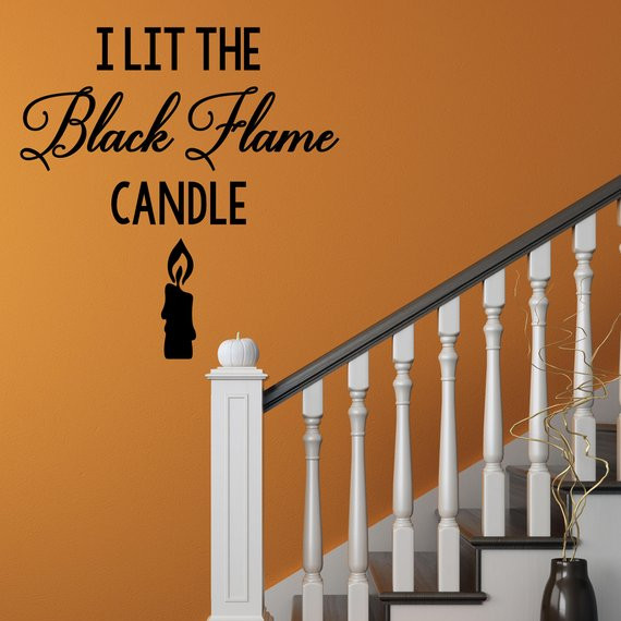"Vinyl Wall Decal that shows a candle and says ""I lit the black flame candle"" by Sticky Thingz"