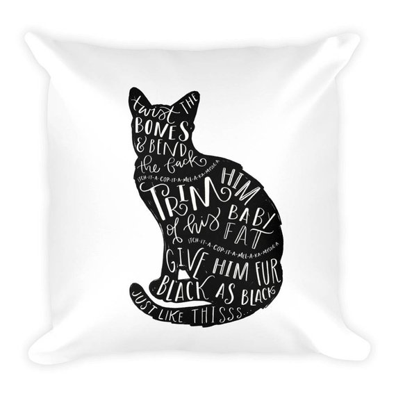 A Hocus-Pocus inspired Halloween Throw Pillow featuring the Silhouette of a black cat, Thackery Binx, and the words to the Twist the Bones spell chanted by the Sanderson Sisters to turn Thackery Binx from boy into Cat. Pillow from The Scribble Stuido on Etsy.