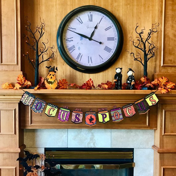 "An adorable handmade banner featuring the phrase ""It's just a bunch of Hocus Pocus"" for Halloween. Banner by shop Brytee Paper Goods on Etsy."