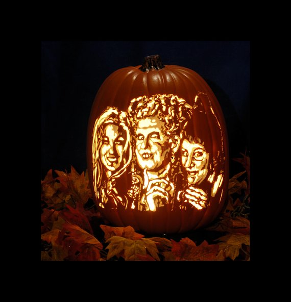 A hand-carved foam pumpkin featuring the Sanderson Sisters from Hocus Pocus