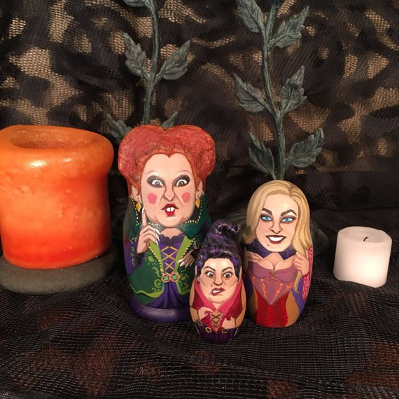 Three amazing hand-painted nesting dolls inspired by the Sanderson Sisters of Hocus Pocus. Created by Leah Shayna