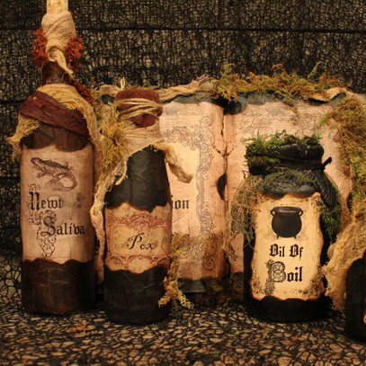 A set of amazing Hocus Pocus inspired home decor, potion bottles and a spell book. From the etsy shop Haunted Moon Emporium.