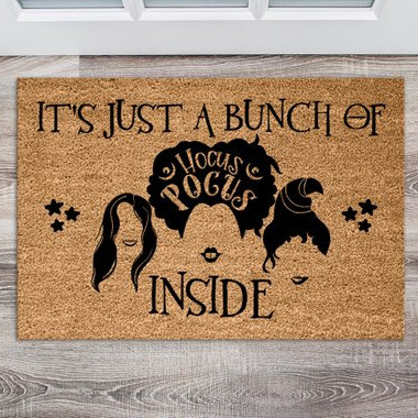 "This fun Hocus Pocus inspired door mat features the hair and lip silhouettes of the Sanderson Sisters and the words ""It's just a bunch of hocus pocus inside"". Rug from Printelle Design on Etsy"