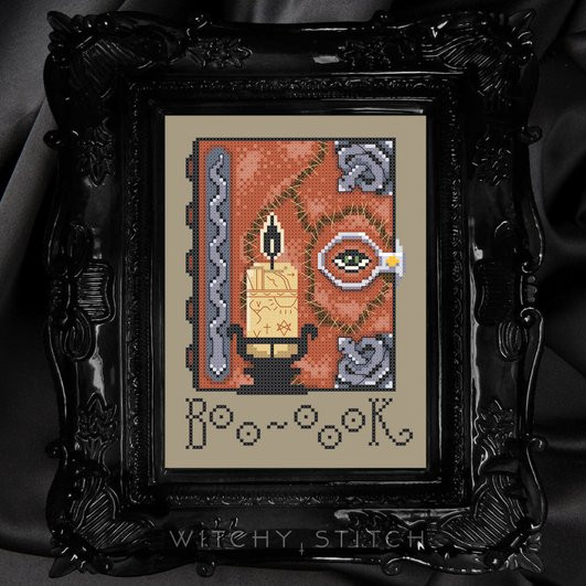 A cross stitch pattern created by Witchy Stitcher on Etsy featuring the spell book from Hocus Pocus and the word Boo-ook as Winnie Sanderson calls out.