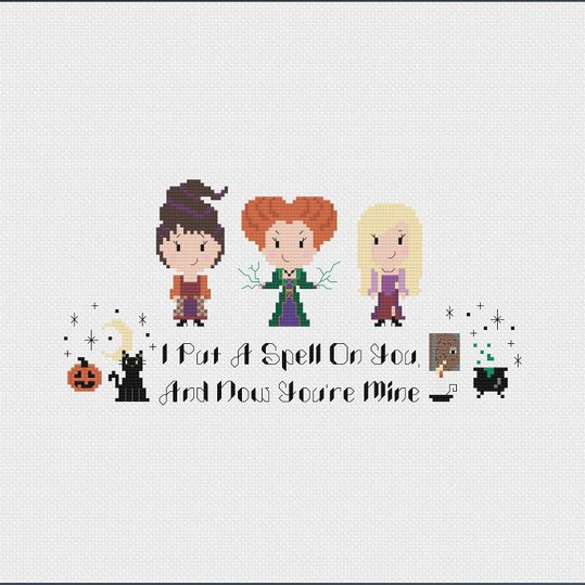 "a Hocus Pocus inspired cross stitch pattern to DIY your own cute little decor. Features the Sanderson sisters, cat, book, cauldron, pumpkin, embellishments, and the words ""I put a spell on you and now you're mine"" by Good Morning Maui"