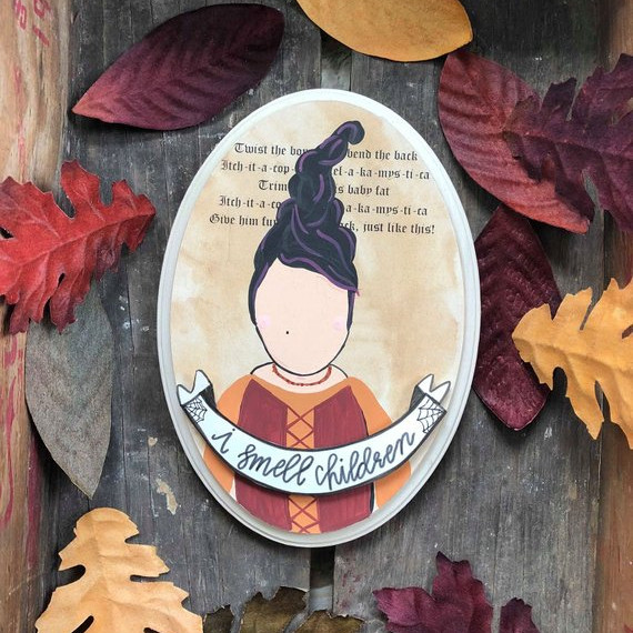 "Sanderson Sister Hocus Pocus art on a wood slice that says I Smell Children and features Mary Sanderson with the quote behind her that says ""Twist the bones and bend the back..."" and the rest of the famous Hocus Pocus Quote. From the shop Noabella & Co on Etsy"