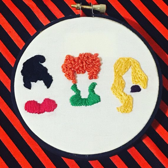 Hocus Pocus inspired embroidery featuring the Sanderson Sisters hair and collars. Art by Floss and Felt