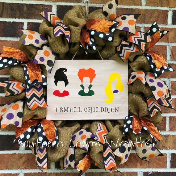 "Halloween wreath featuring the silouhetts of the sanderson sisters and the words ""I smell Children"" on burlap. Wreath by Southern Charm Wreaths."