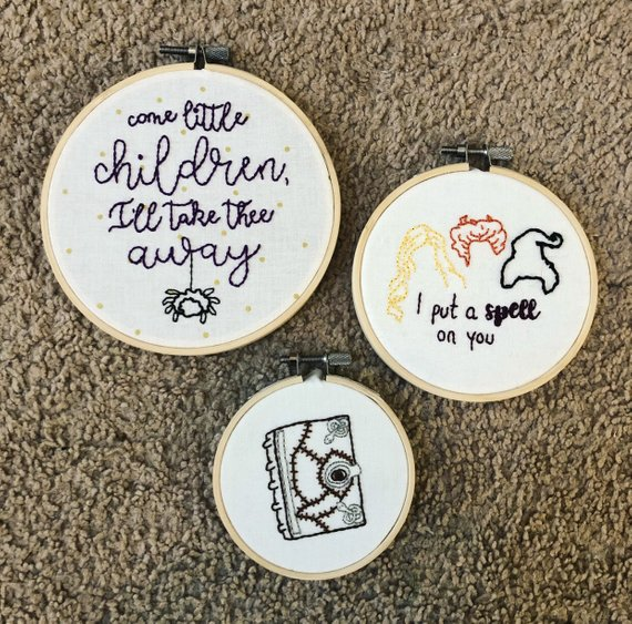 Three hocus pocus embroidery patterns by Little Beasties Shop on Etsy. One features the book, one features the hair of the Sanderson Sisters with