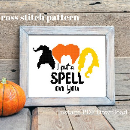 A Hocus Pocus cross stitch pattern featuring the hair of the witches and the words