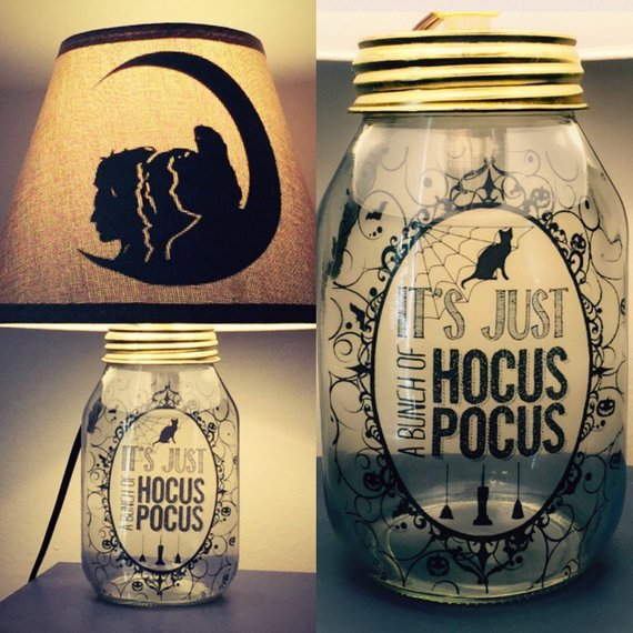 An amazing Mason jar lamp featuring Hocus Pocus inspired imagery and words on the jar and the lamp shade. From Practically Perfect Crafts on Etsy.