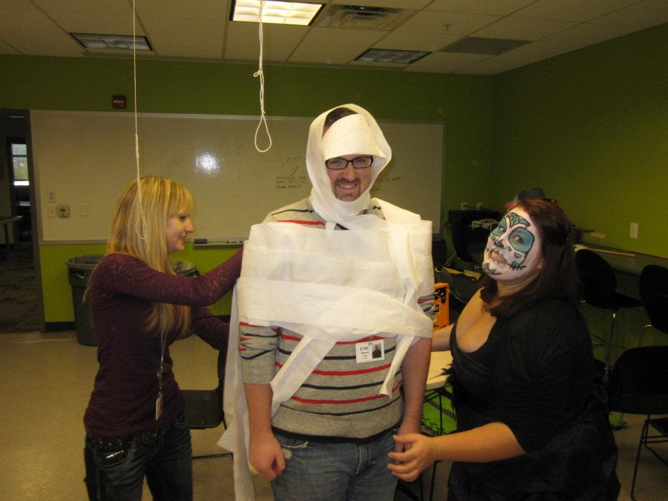 Playing the Mummy Wrap Game with Shawn at our Company Halloween Party