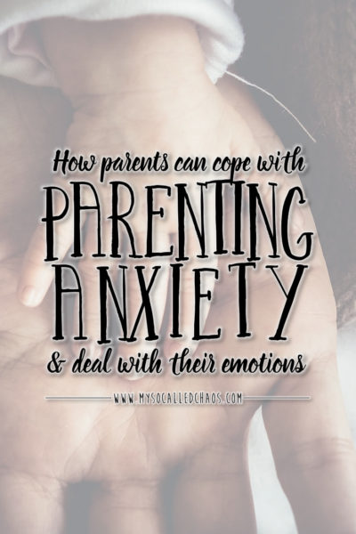 How Parents can cope with parenting anxiety and deal with their emotions. Image of a child putting their hand on an adult's hand.