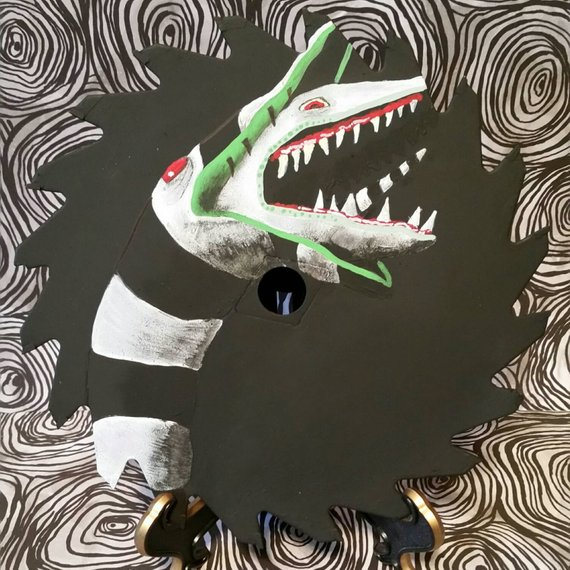 Sandworm from Beetlejuice painting on a circular saw blade by Glitter and Rock and Role on Etsy