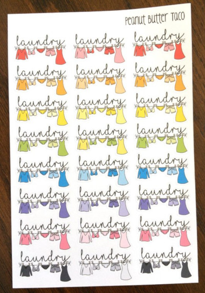 Rainbow Clothesline Planner Stickers by Peanut Butter Taco featuring the word laundry over a colorful clothesline filled with clothes - cleaning planner stickers